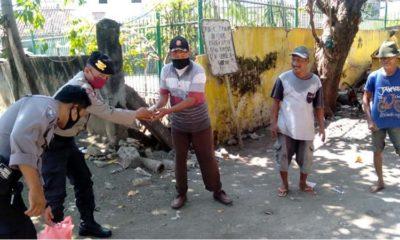 Ringankan Beban Masyarakat, Polres Pasuruan Kota Bagikan Sembako