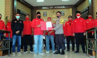 Pengurus PDIP Kabupaten Pasuruan menyampaikan surat resmi ke Kapolres Pasuruan. (ist)